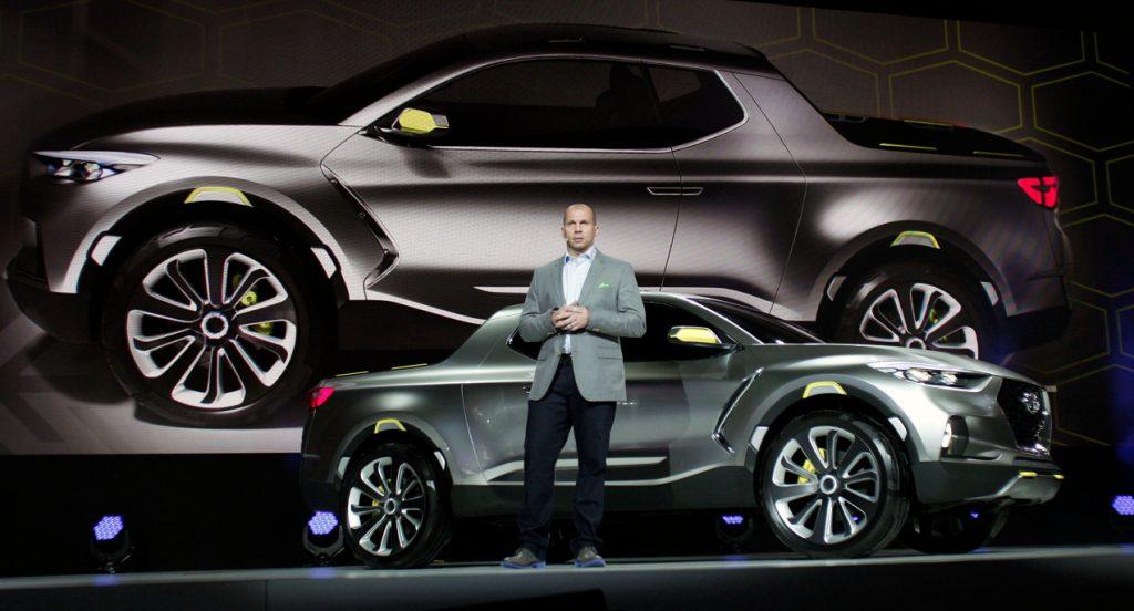 Hyundai Motors America Director of Corporate Planning, reveals a silver Hyundai Santa Cruz concept to the media at the 2015 North American International Auto Show (NAIAS) on January 12, 2015 in Detroit, Michigan.