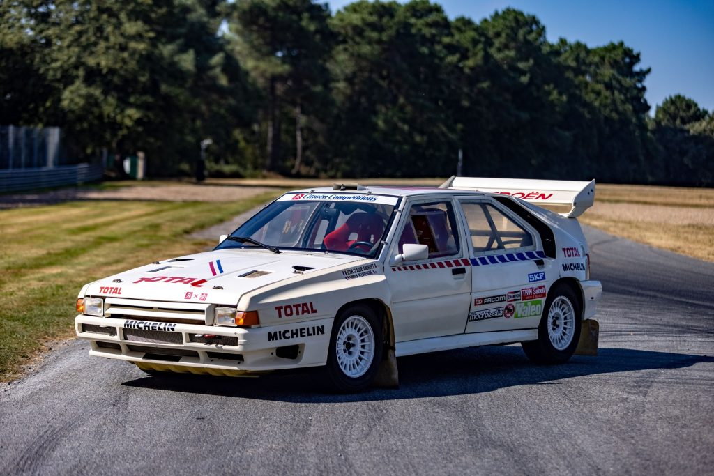 Jean-Claude Andruet's white-with-blue-and-red-stripes 1986 Citroen BX 4TC Evolution race car