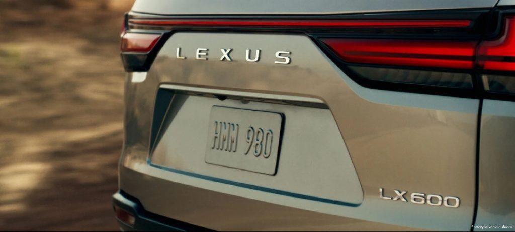 The rear of a gold prototype 2022 Lexus LX 600.