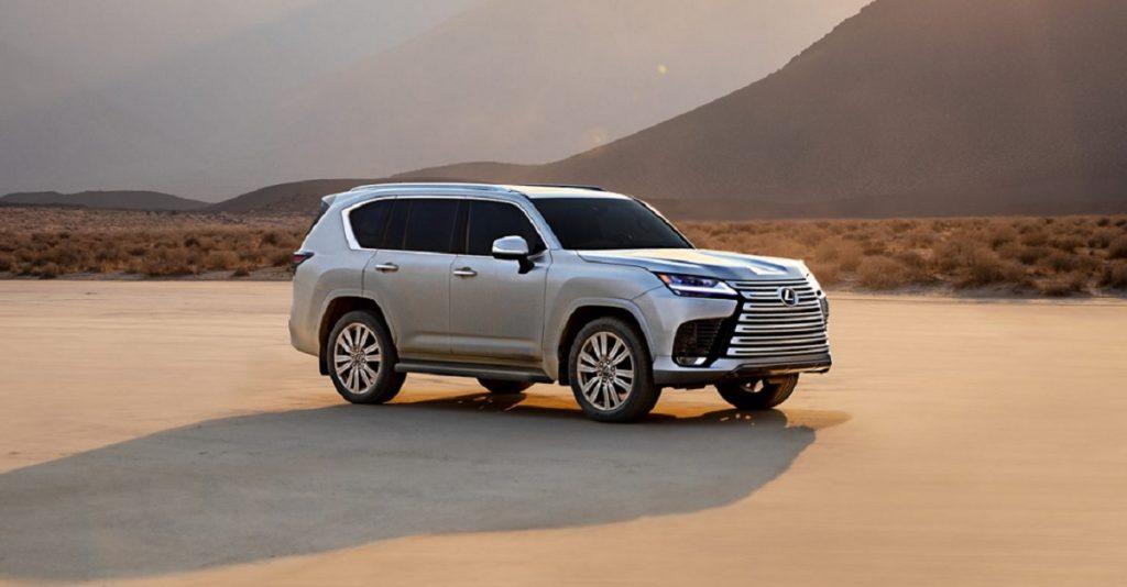 A silver 2022 Lexus LX 600 sitting in a desert.