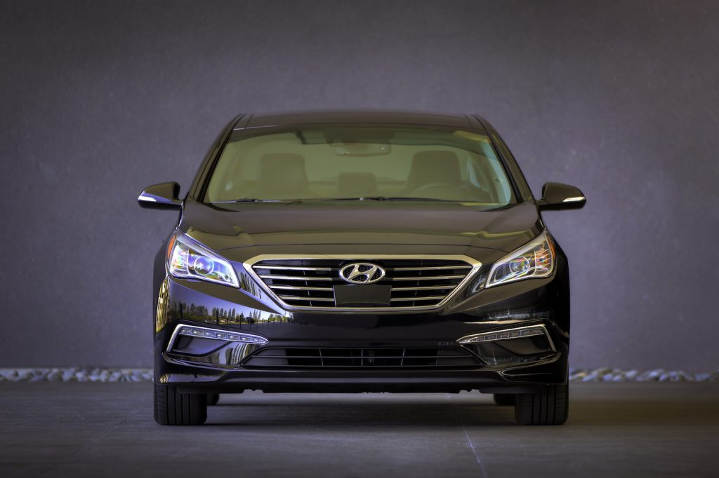 This is a promotional photo of the front of a black 2015 Hyundai Sonata. 466,000 Sonata sedans are at risk of a turn signal malfunction and affected by Hyundai recall. | Hyundai
