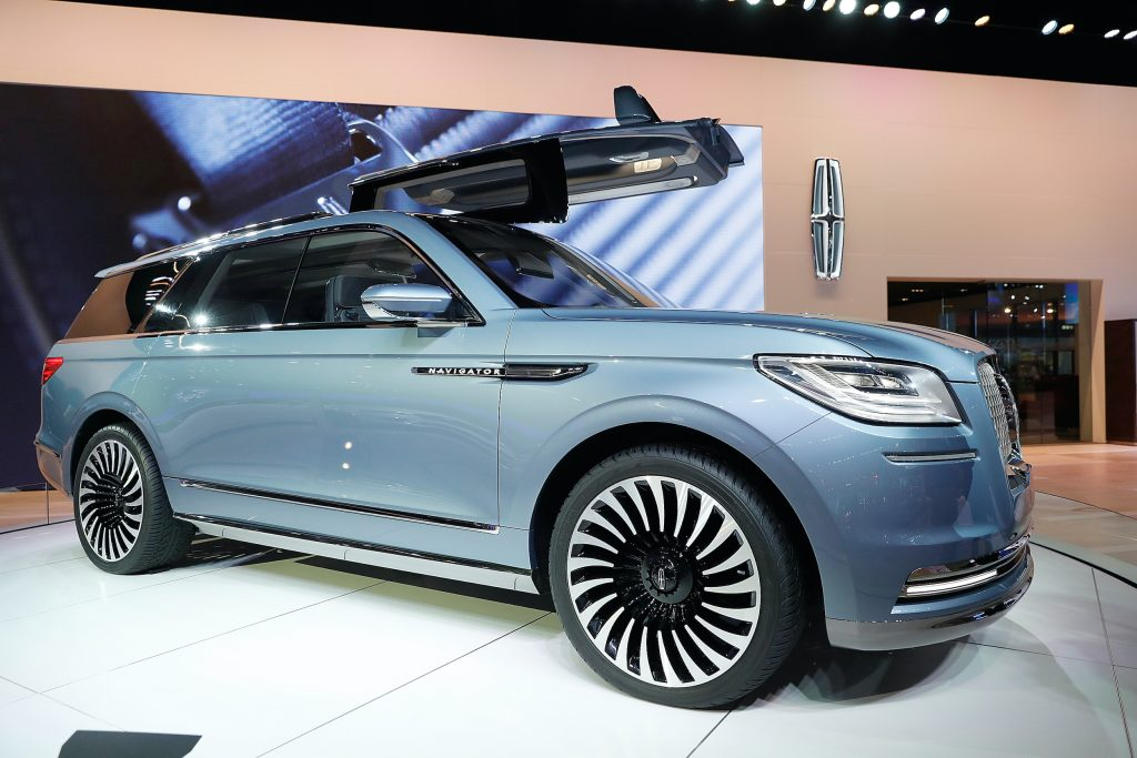 A blue Lincoln Navigator on display at an auto show