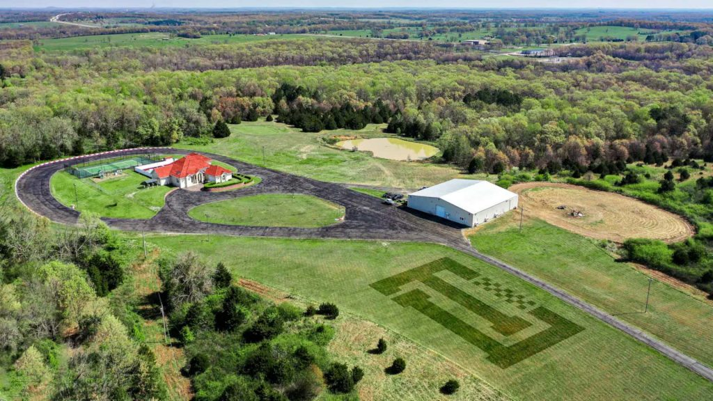 an areal veiw of the property with the race tracks visable