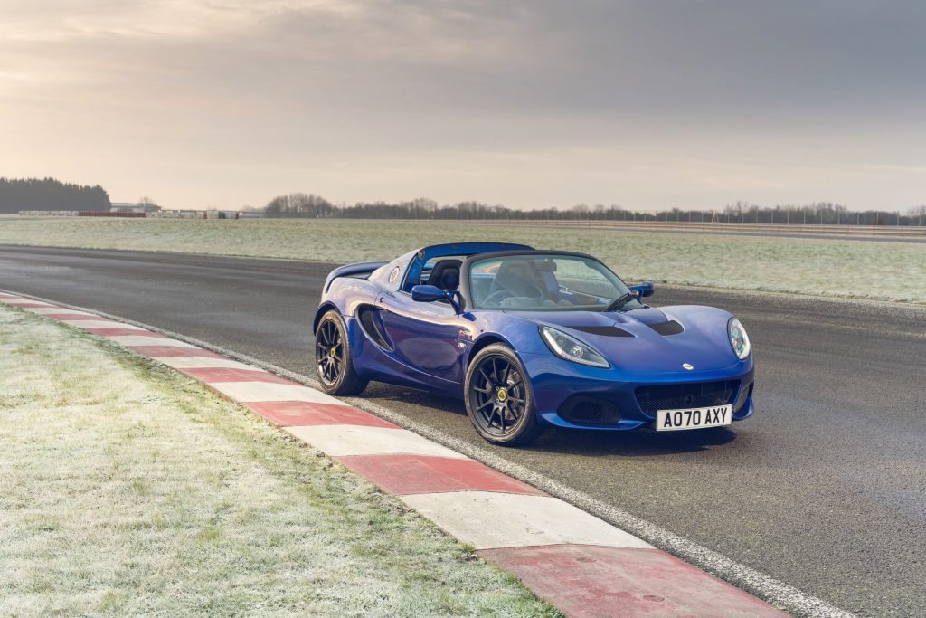 A blue Lotus Elise Sport 240 Final Edition on a frost-coated racetrack