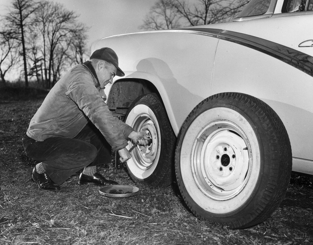 Man Changing A Full-Sized Spare Tire