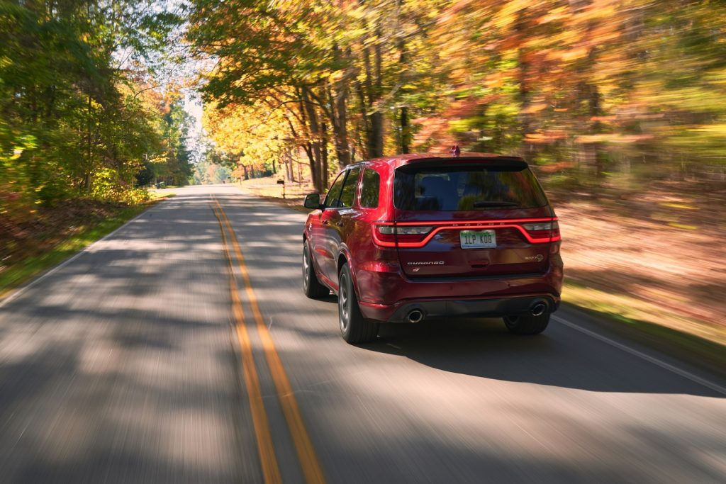 This is a promotional photo of the 2021 Dodge Durango SRT Hellcat in octane red. Dodged may have Killed The Durango Too Soon, the most recent SUV won Multiple Best Midsize SUV 2021 List Awards   Stellantis