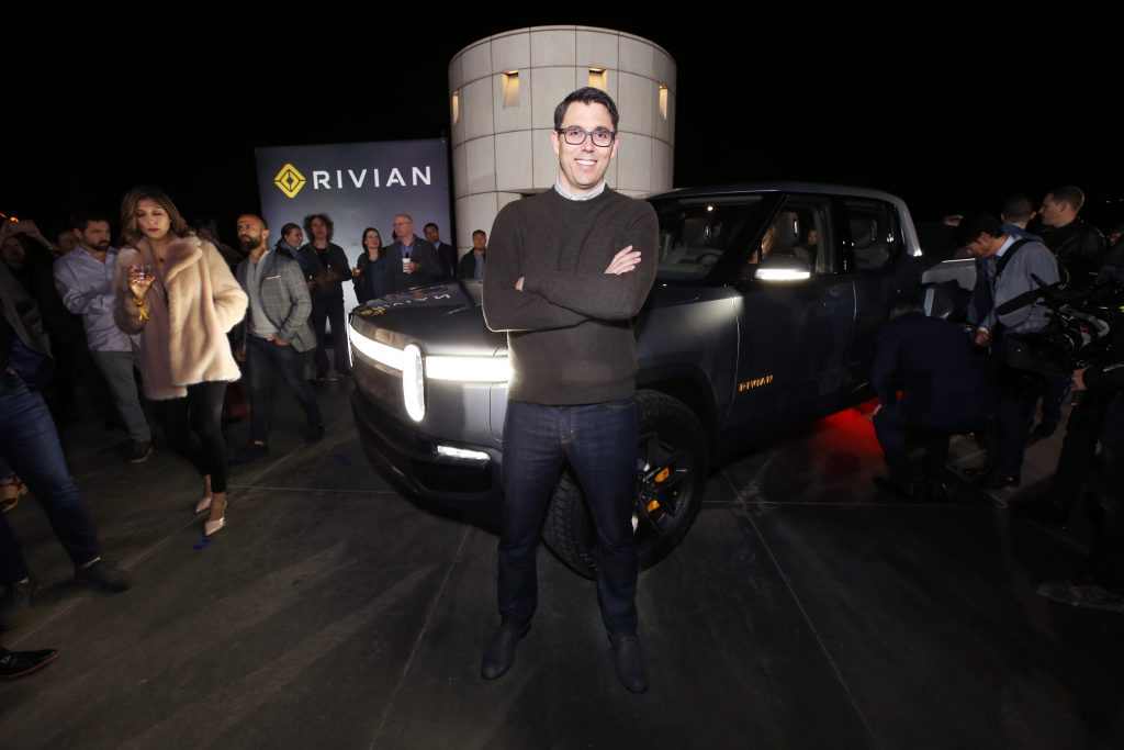 R.J. Scaringe standing in front of Rivian R1T