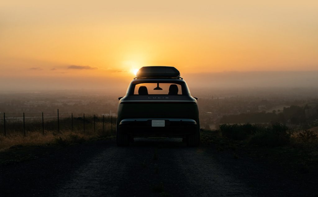 Rear view of Lucid Gravity electric crossover SUV with the sunset in the background