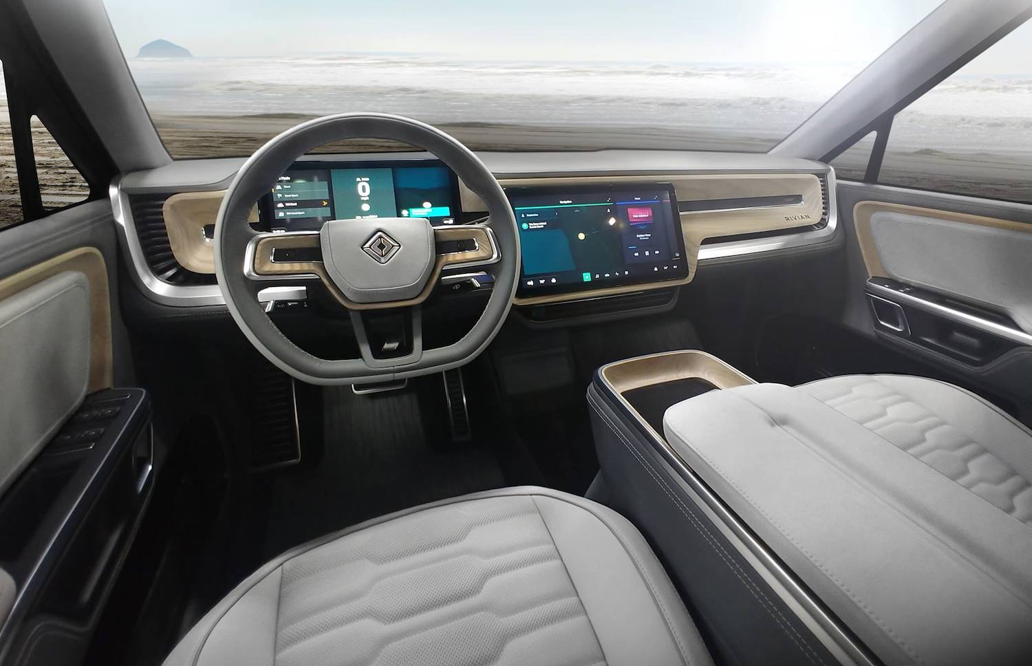 This is a promo photo of The Rivian Interior In The R1T Electric Pickup, parked by the ocean | Rivian