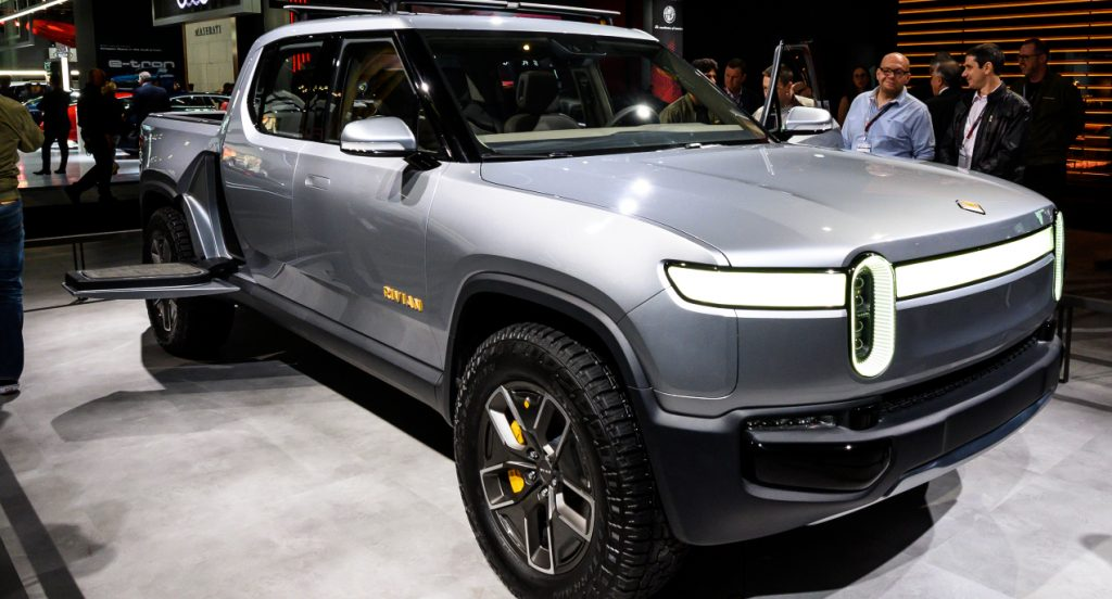 A gray Rivian R1T electric truck is on display.