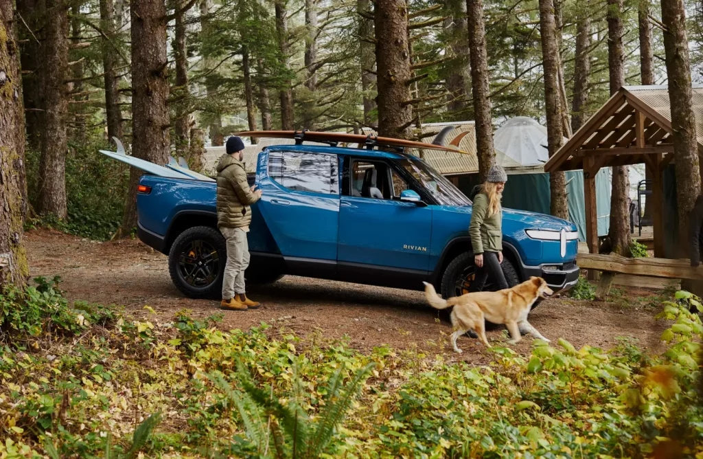 This is a promotional photo of a blue 2022 Rivian R1T Pre-Production Model. Rivian Electric Truck Designed for Luxury, Not Overlanding, Despite Rivian Off Road Capabilities.   Rivian