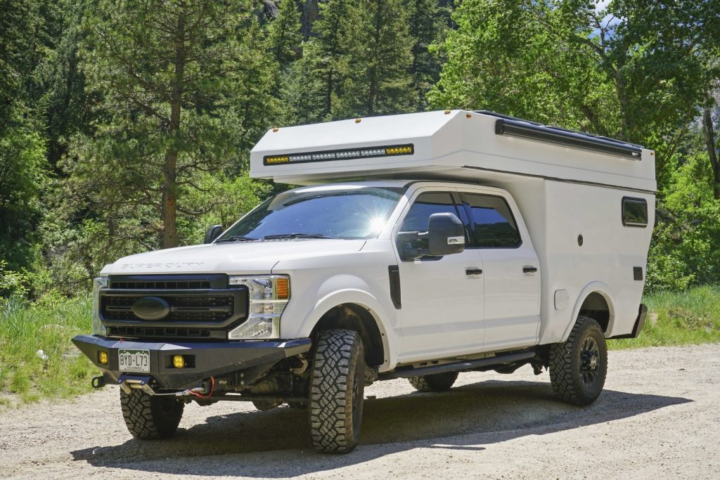 The Rossmönster Ford F-150 Baja camper truck seen parked in a gravel pit