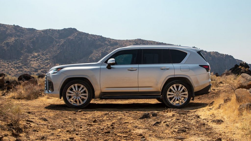 Silver 2022 Lexus LX 600 with mountains in the background