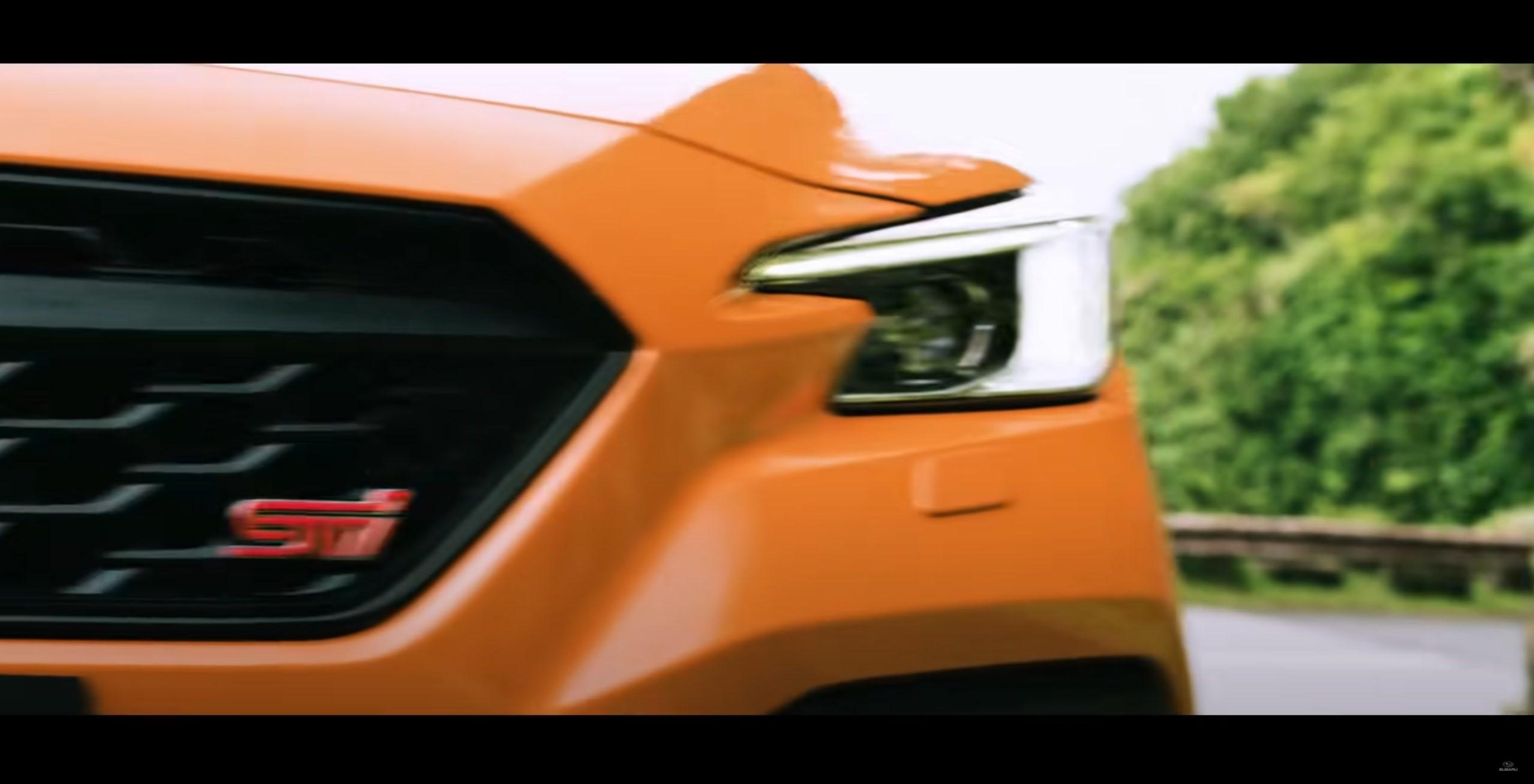 The front grille of the orange 2022 Subaru WRX STI S4