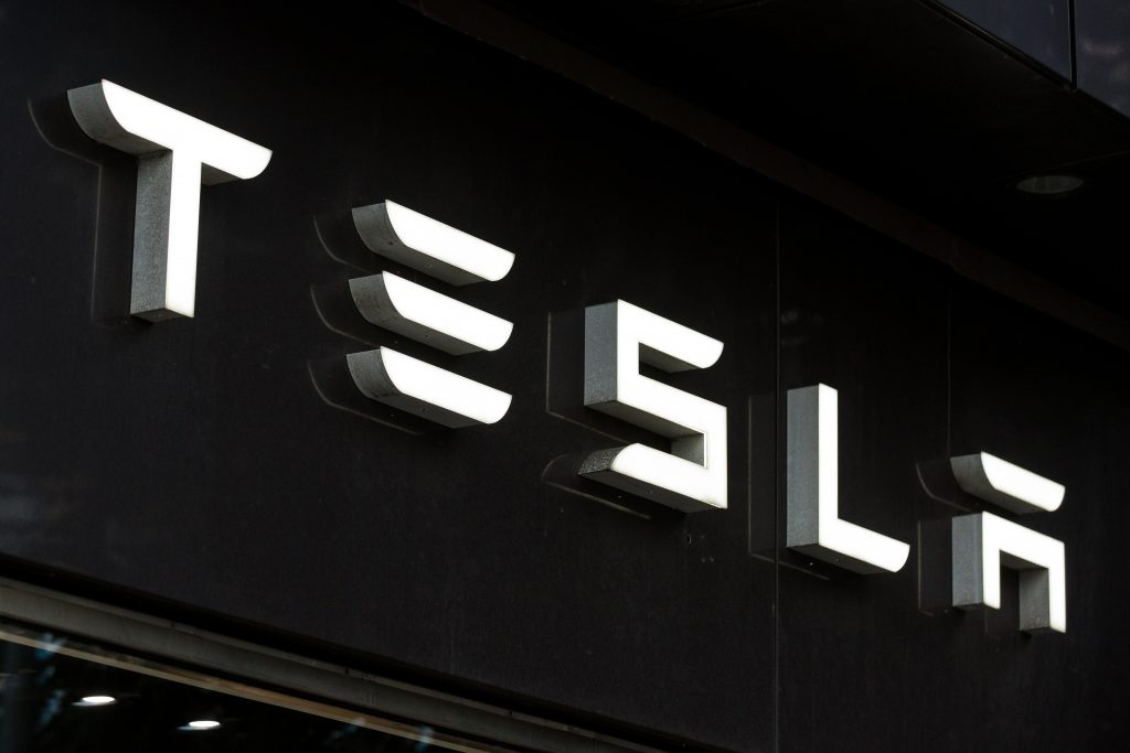 Tesla logo written out in white on a black background.