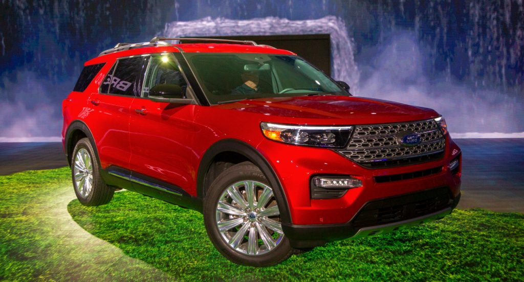 A red Ford Explorer is on display.