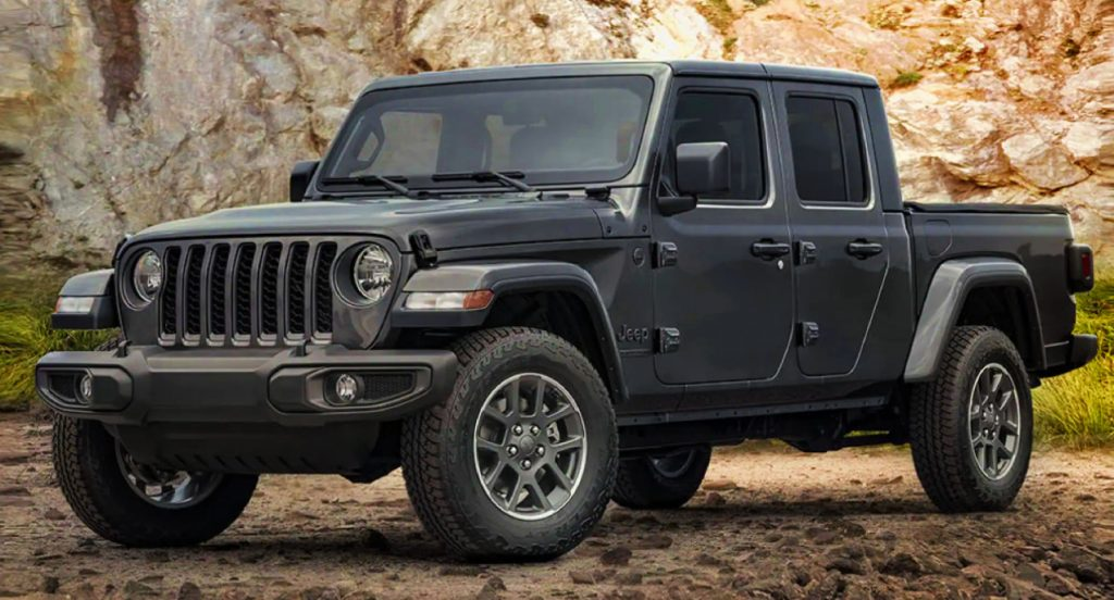 A black 2021 Jeep Wrangler is parked in a rocky area.