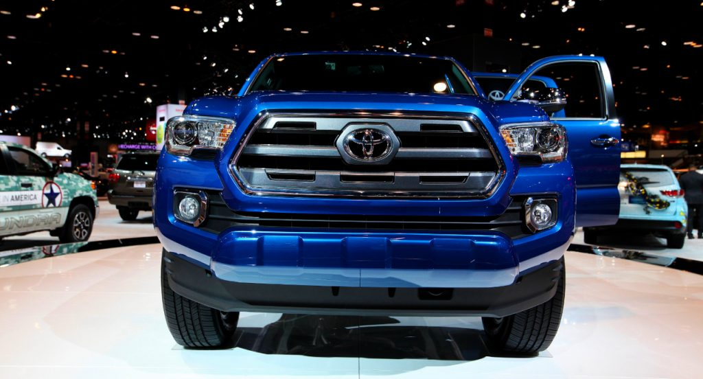 A blue Toyota Tacoma is on display.