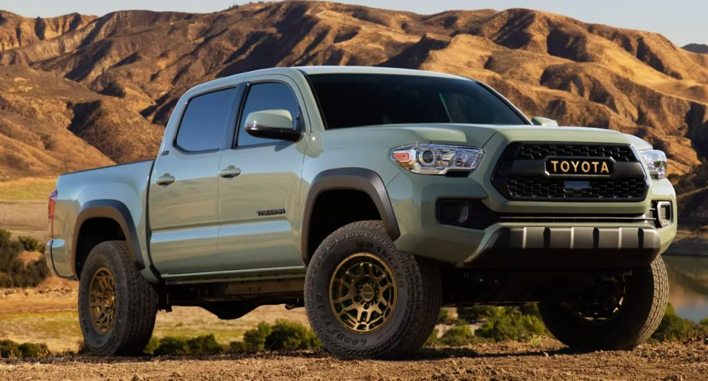 A  moss green Toyota Tacoma in a desert. The Toyota Tacoma is one of the fastest-selling cars.