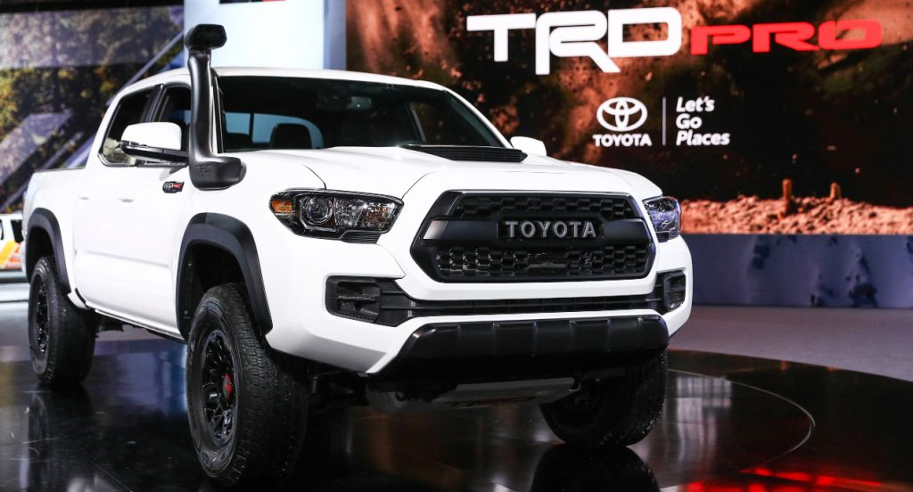 A white Toyota Tacoma TRD Pro is on display.