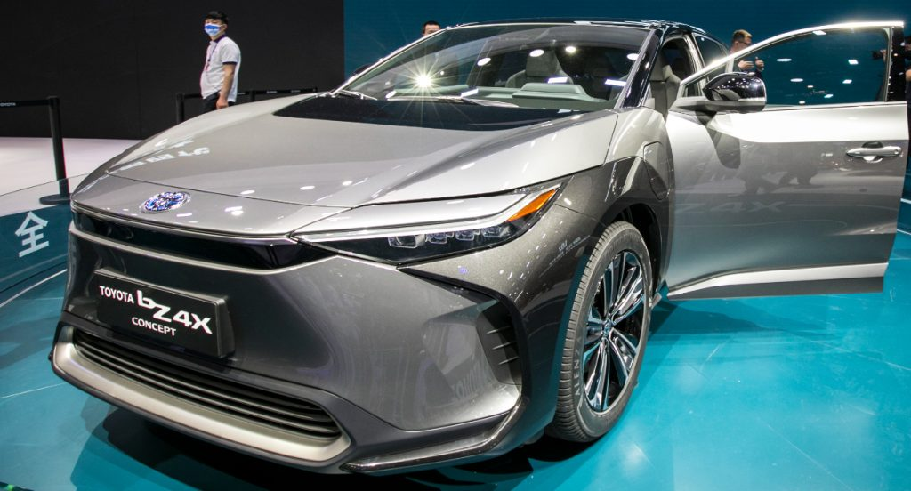 A silver 2022 Toyota bZ4X electric SUV is on display.