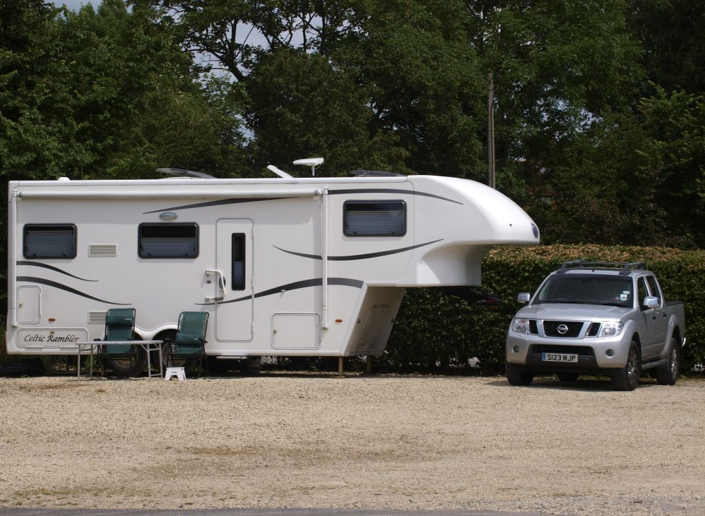 Truck Parked Next To Fifth-Wheel Camper
