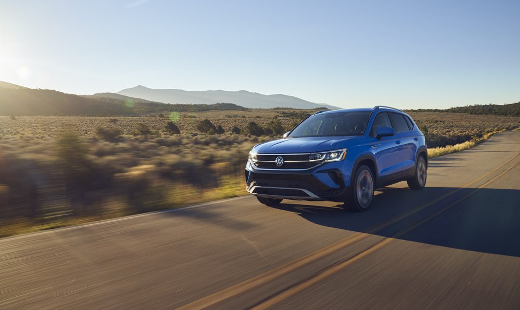 The 2022 Volkswagen Taos driving on the road