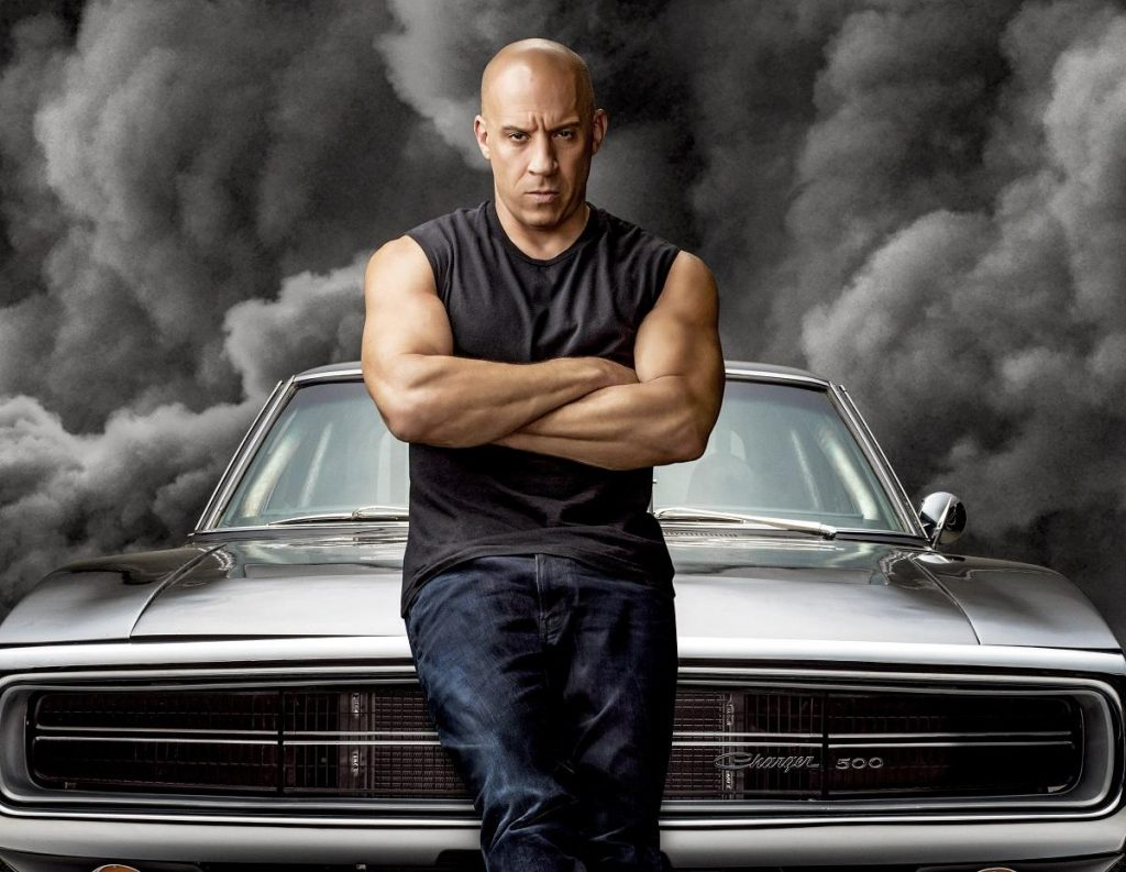 This is a publicity photo of Vin Diesel and a 1970 Dodge Charger 500. This is only one of Dom's Chargers in F9: Vin Diesel Drives Five Different Dodges in the Latest Fast and Furious Movie. | Universal Studios