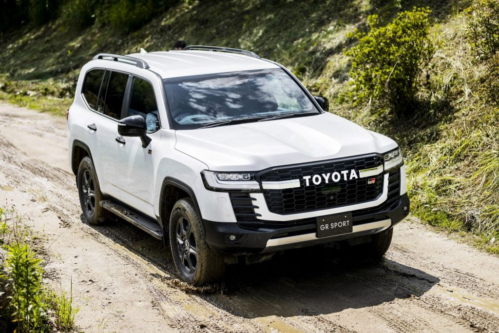 White 2022 Toyota Land Cruiser driving on a muddy road