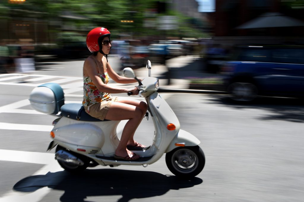 Woman Riding On Moped