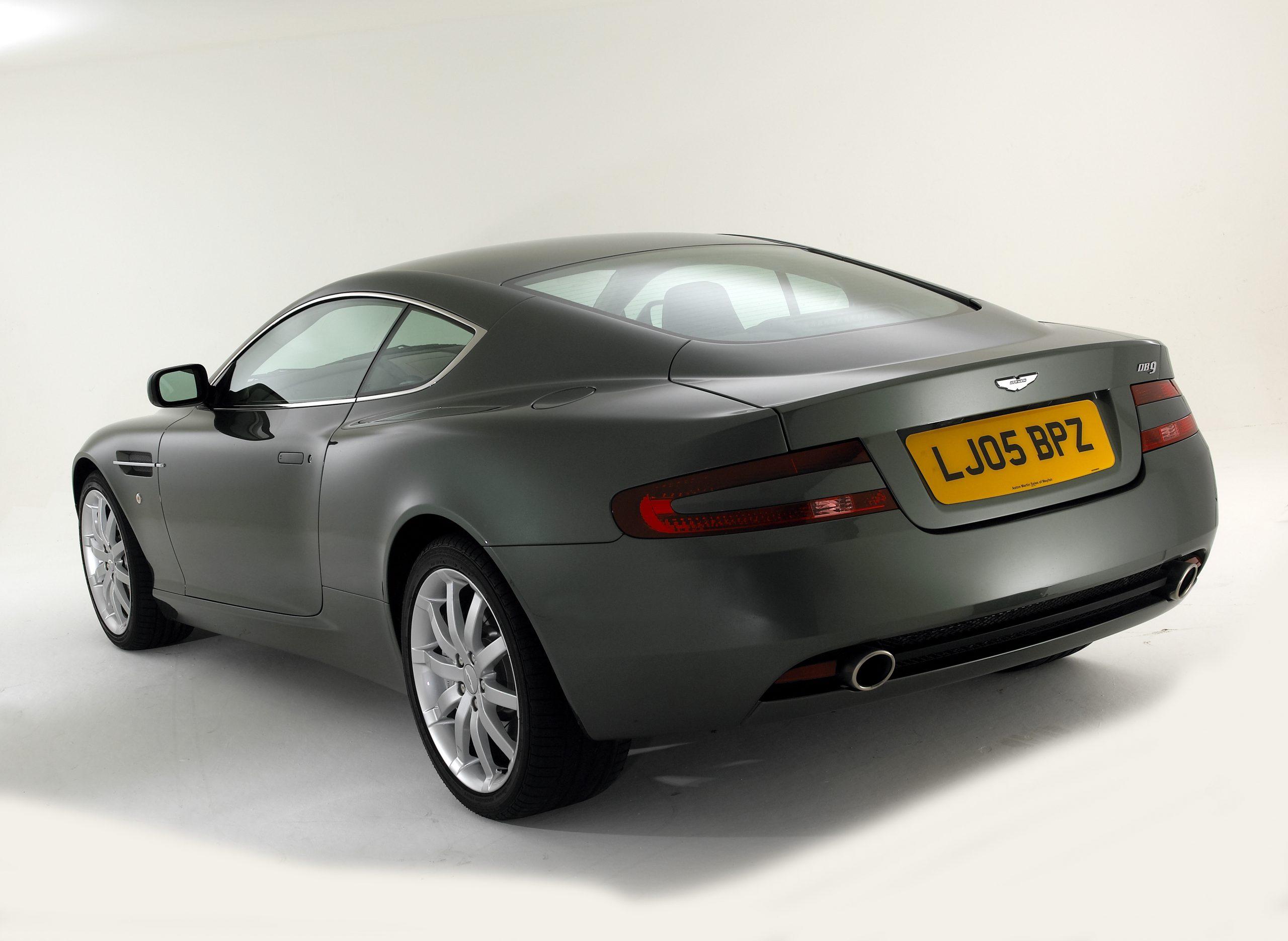 The rear 3/4 of the Aston Martin DB9 shot in a studio