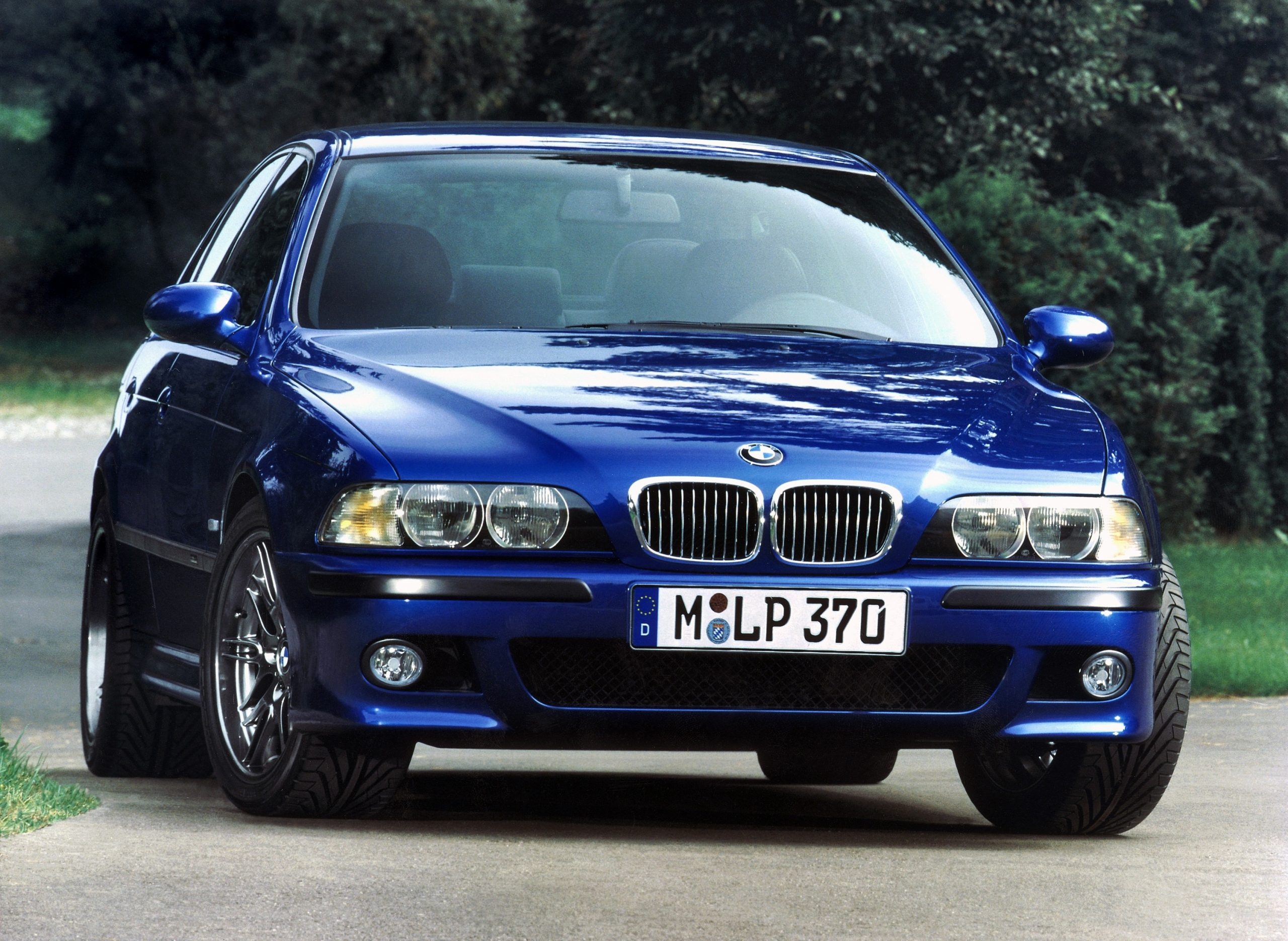A blue E39 BMW M5 shot from the font 3/4 angle