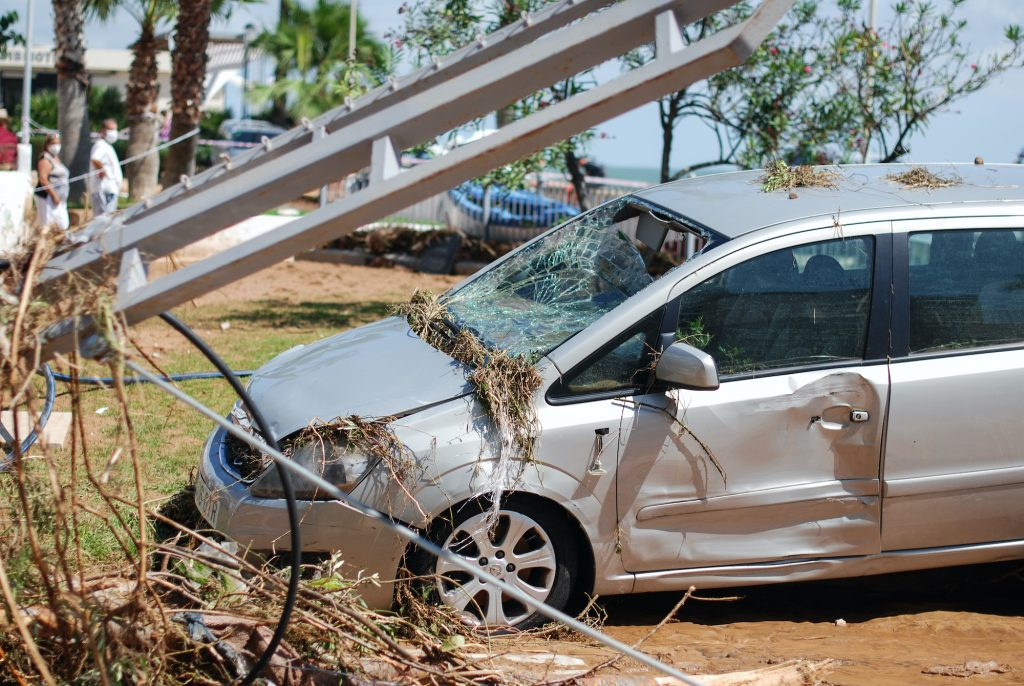 A car was damaged by flooding on a street filled with mud and derbis the day after the flash floods of September 2, 2021 in Les Cases d'Alcanar, Spain.