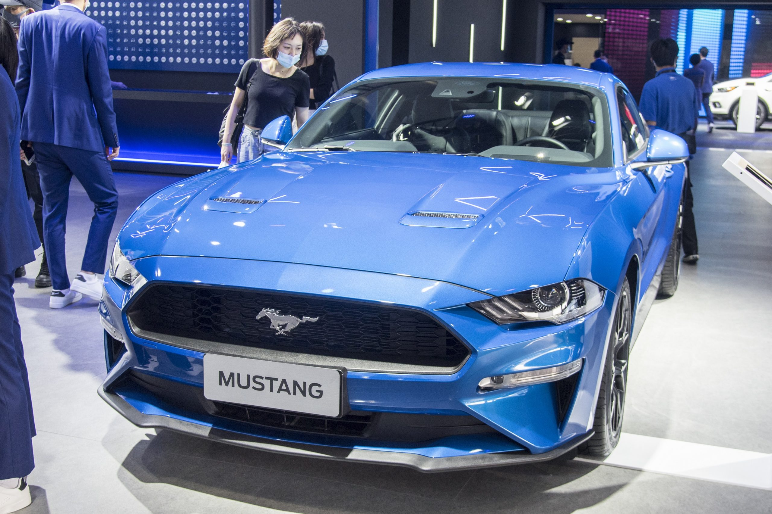 A dark blue 2020 Ford Mustang shot from the 3/4 angle at an auto show in China