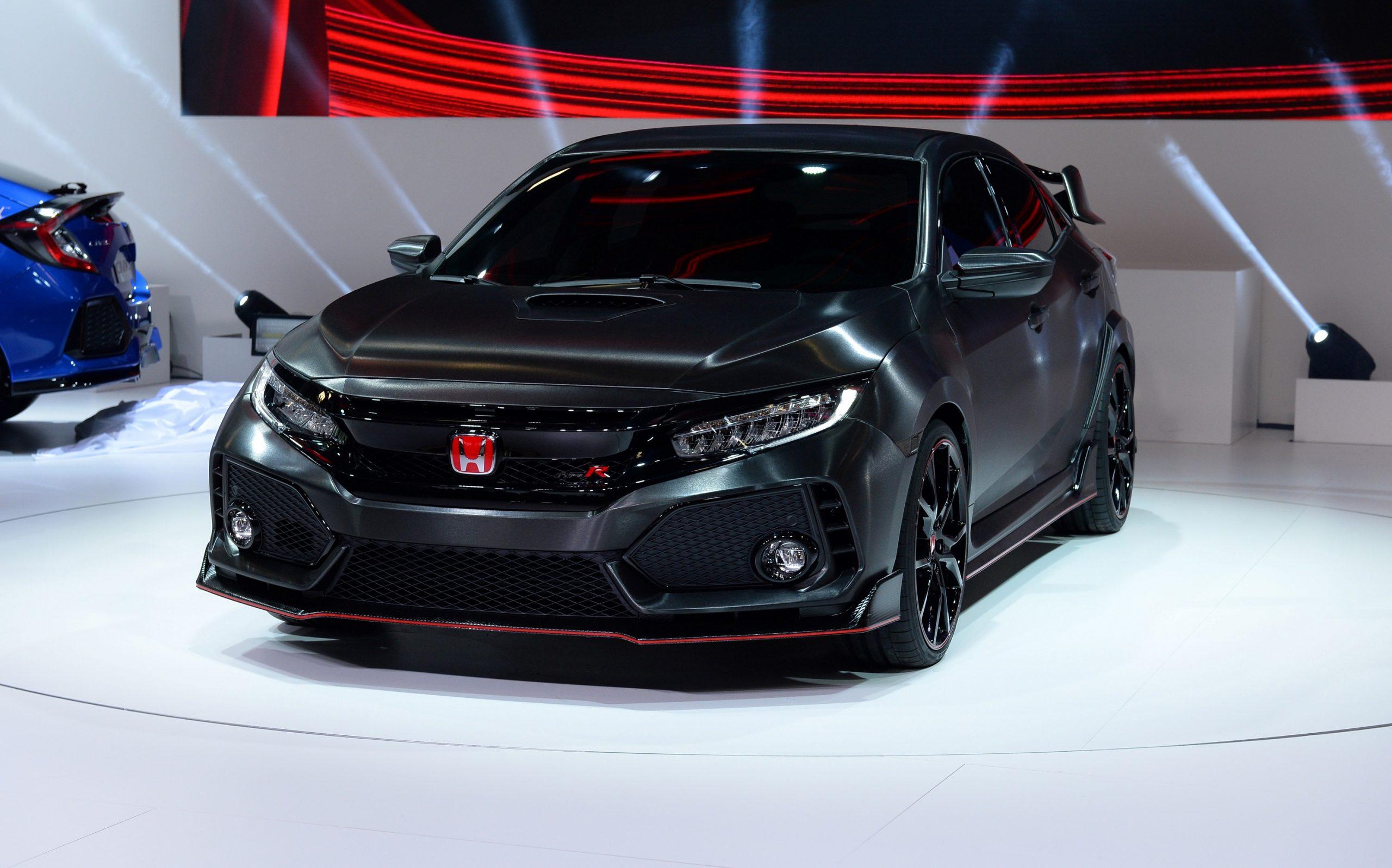 A black 2022 Honda Civic Type R shot at a motor show in Paris