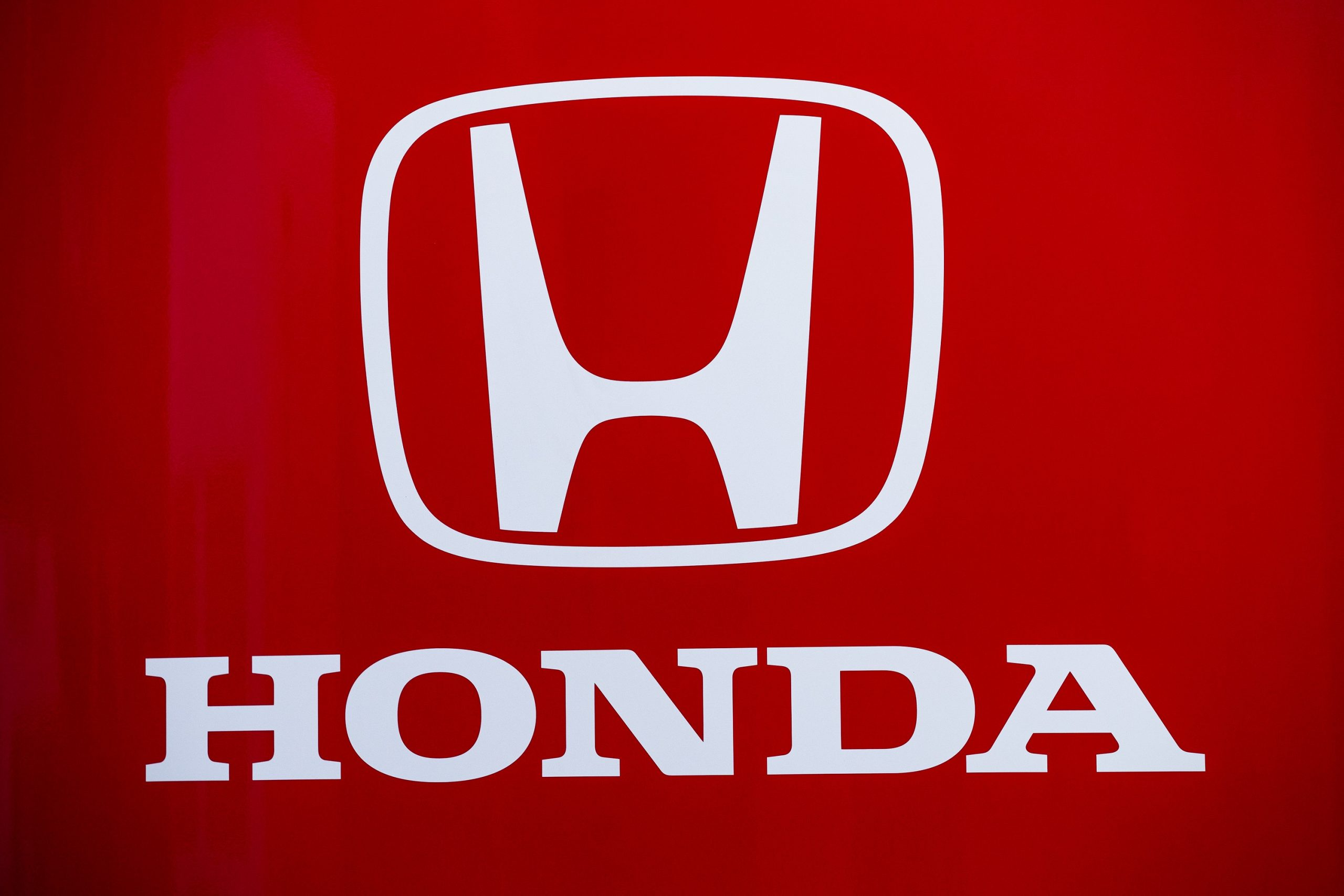 The Honda logo in white against a red background