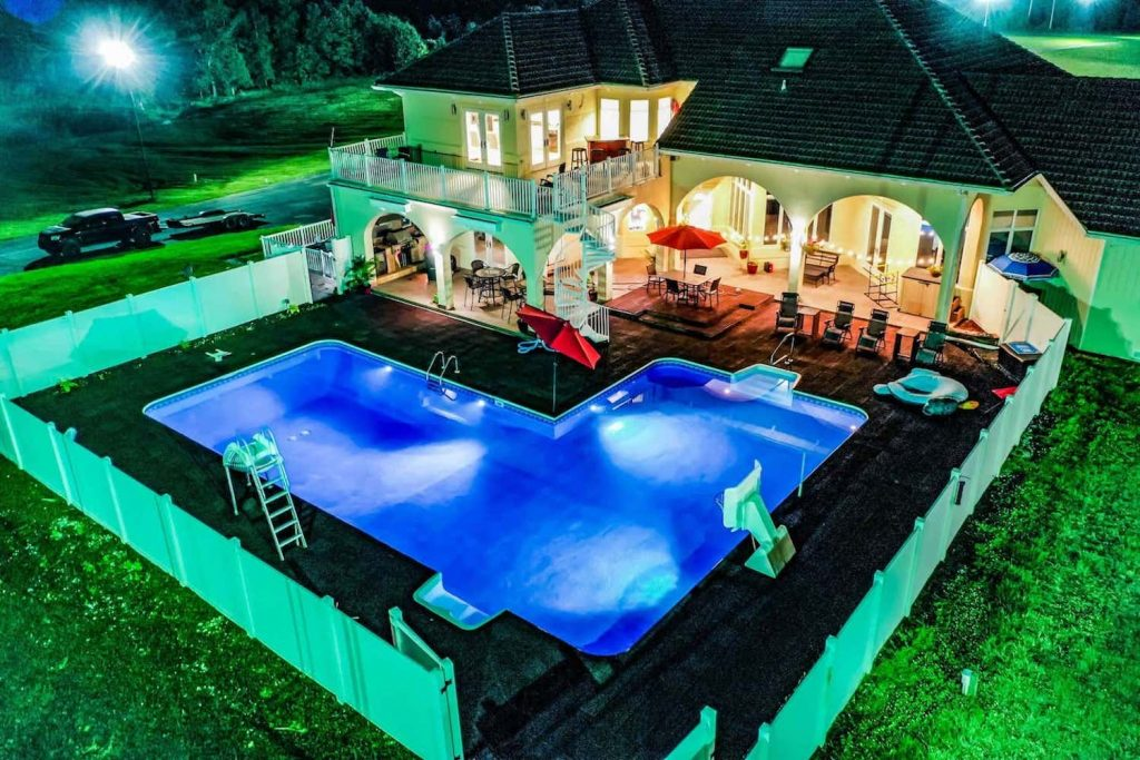 a photo the Little Talledega Airbnb and its huge swimming pool