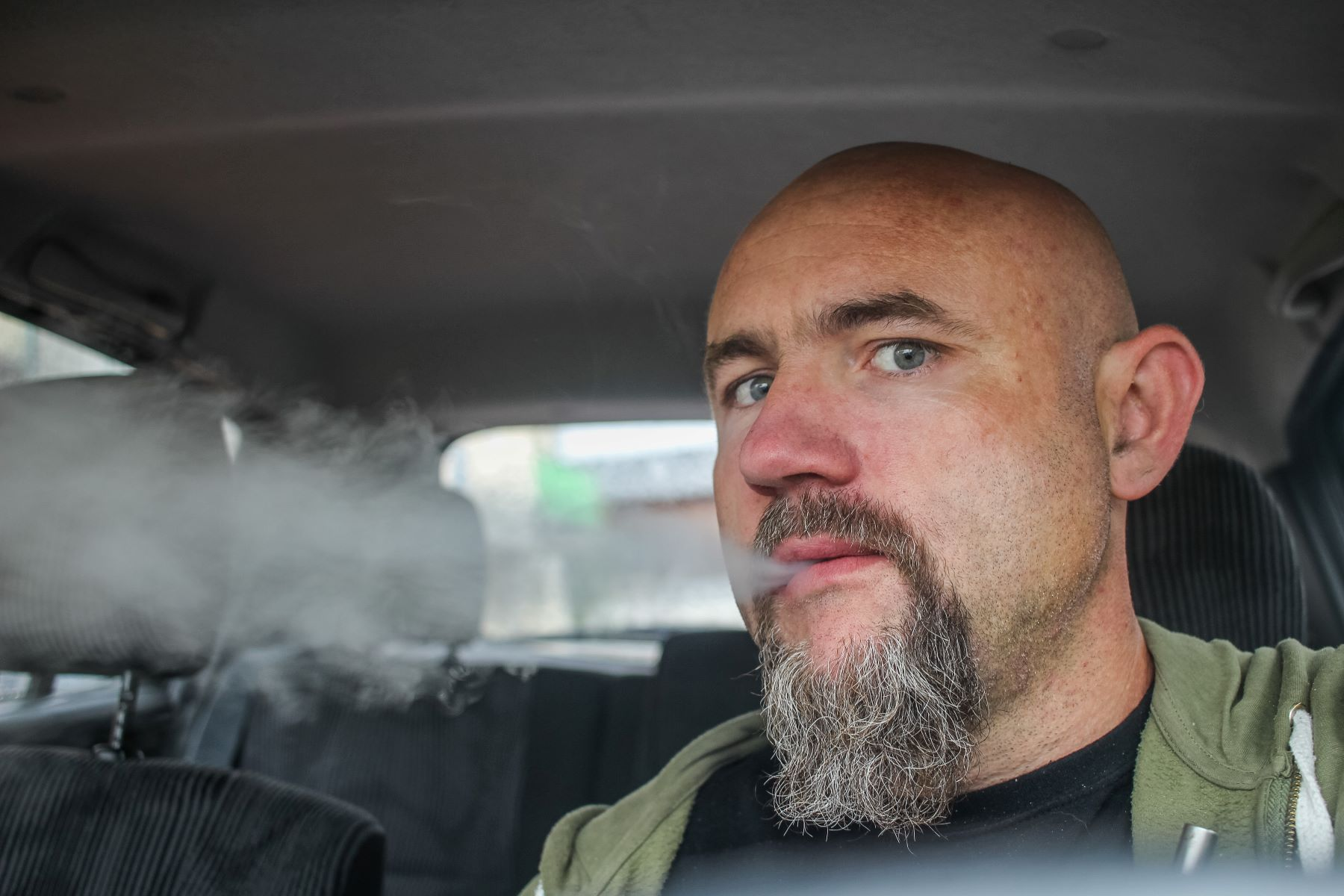 A man smoking in a car in Gdansk, Poland