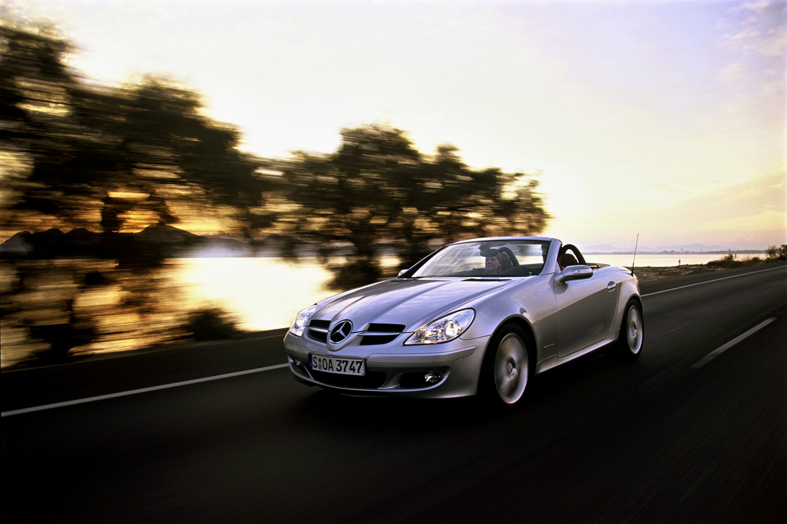 A silver Mercedes-Benz SLK55 shot from the front 3/4