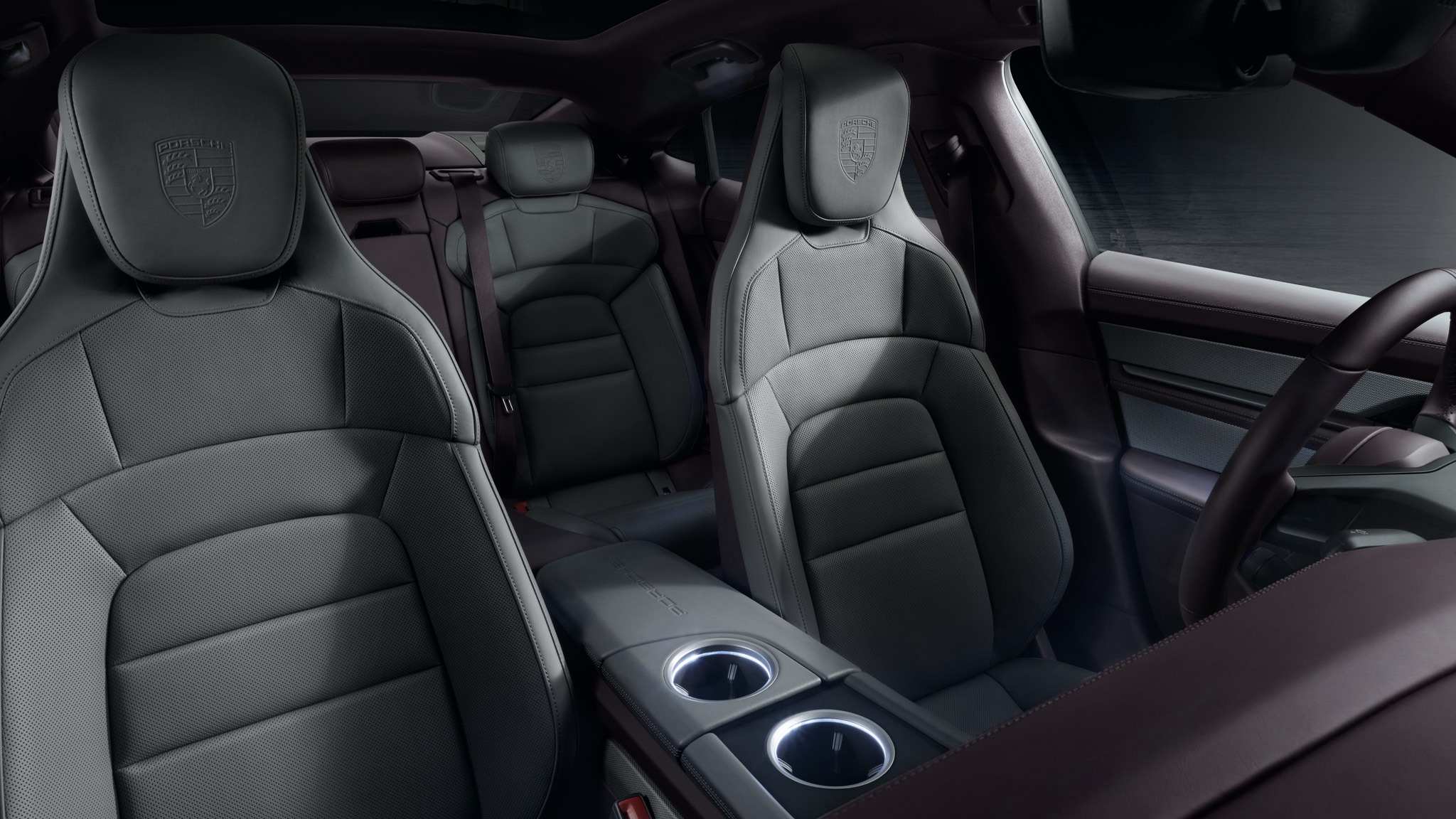 The interior of the Taycan, with cream leather seats and a pink dash