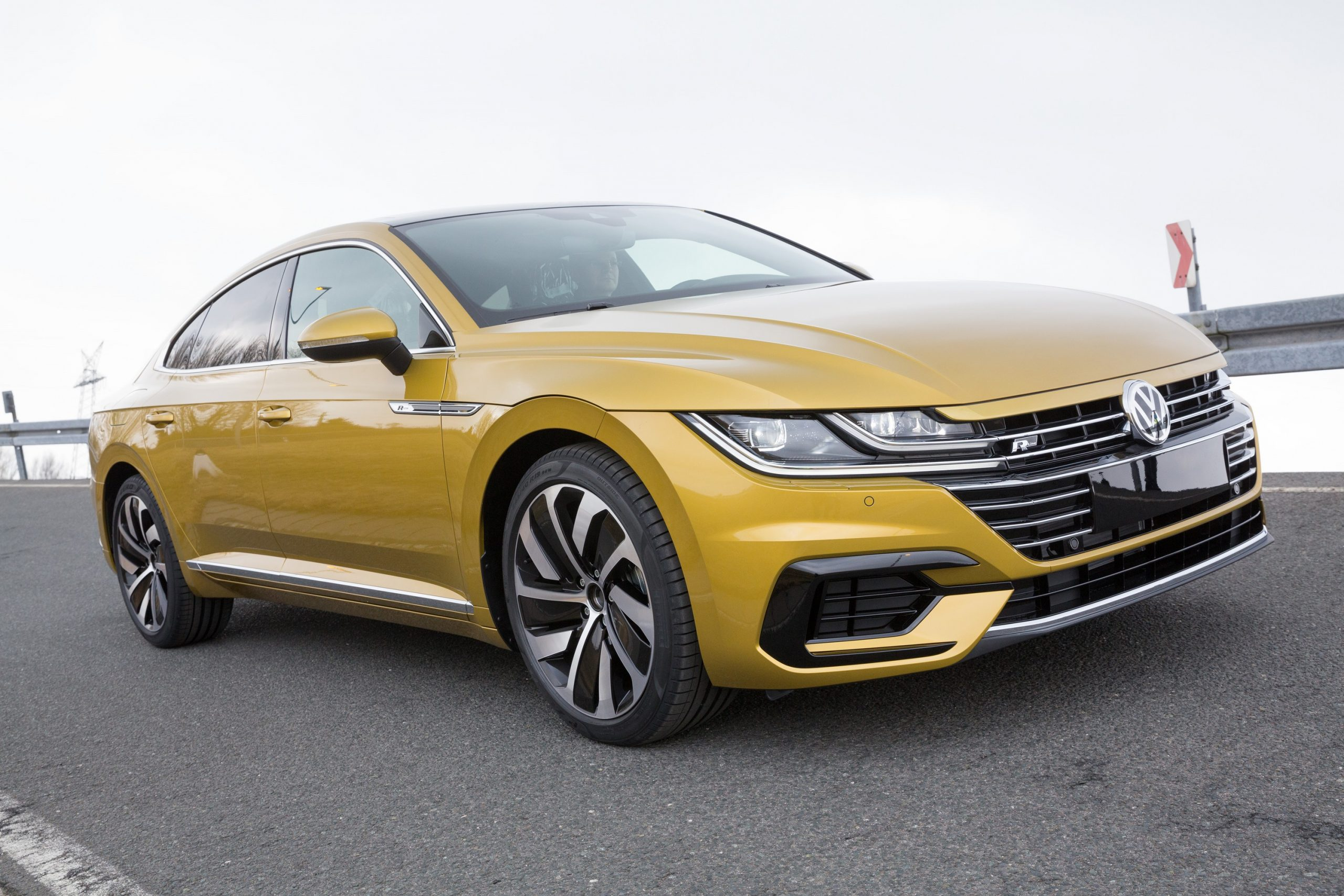 A yellow Volkswagen Arteon R shot from an angle