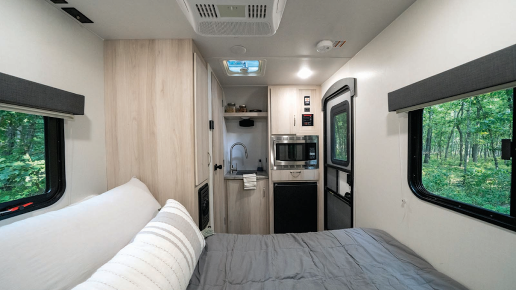 The 2022 Winnebago Hike 100 interior with bed and tiny kitchenette